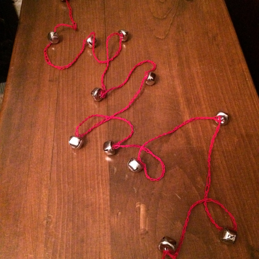 crocheted garland with jingle bells attached hand made in canada sugarbush
